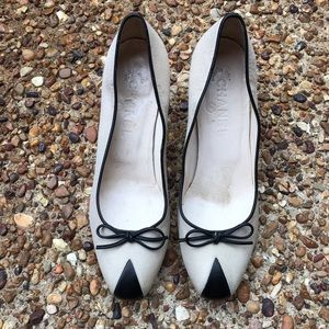 CHANEL beige and black kitten heel pumps.